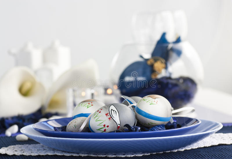Easter table setting in blue and white royalty free stock images