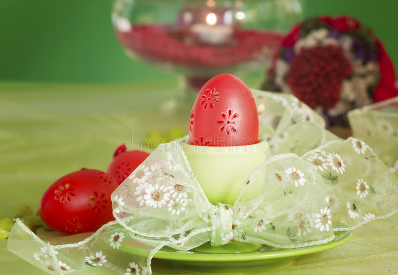 Easter table setting in green and red royalty free stock photos