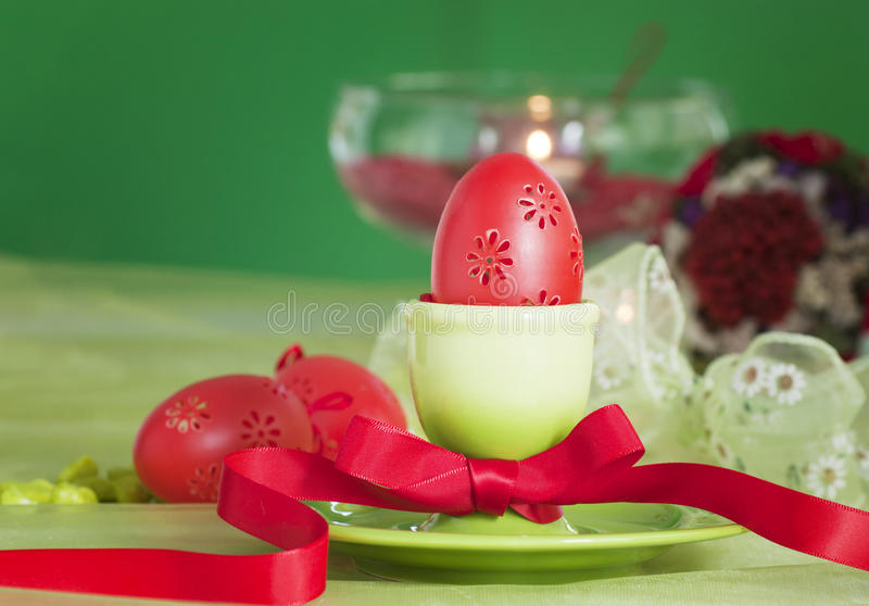 Easter table setting in green and red royalty free stock photo
