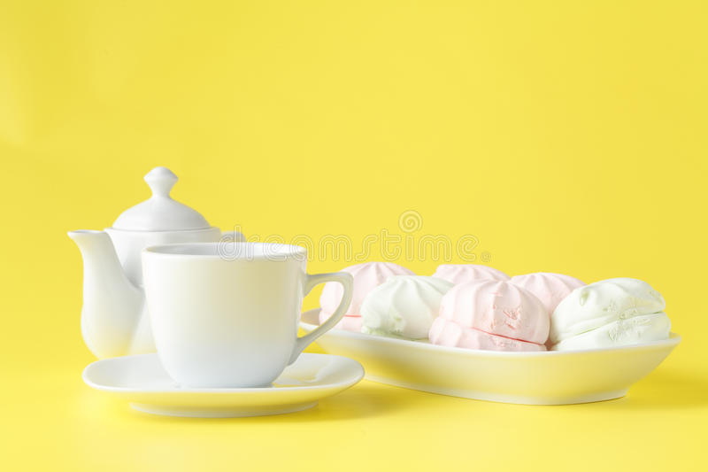 Easter table setting with holiday decor on yellow background royalty free stock image