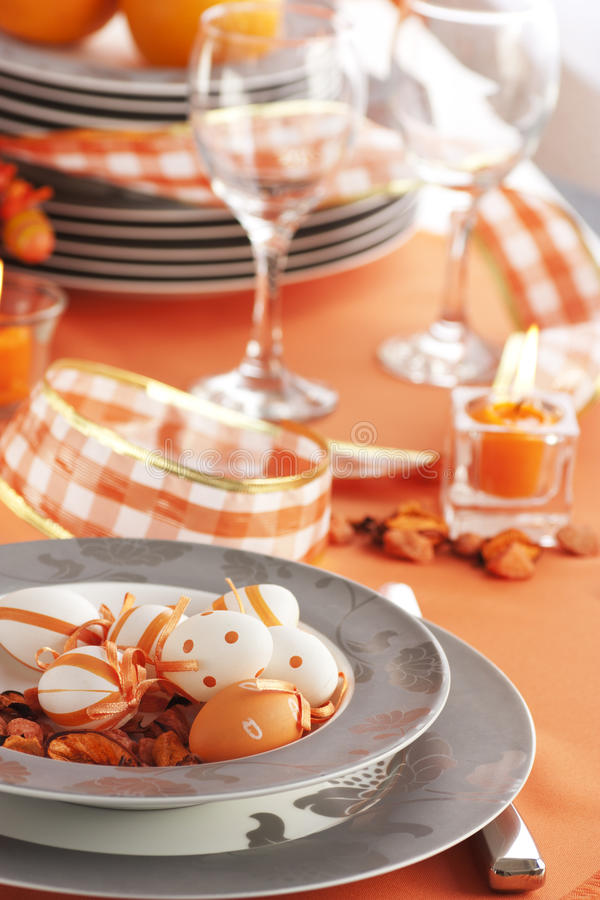 Easter table setting in orange tones stock image