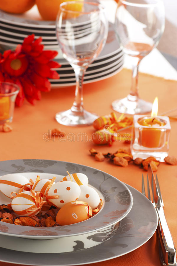 Easter table setting in orange tones royalty free stock image