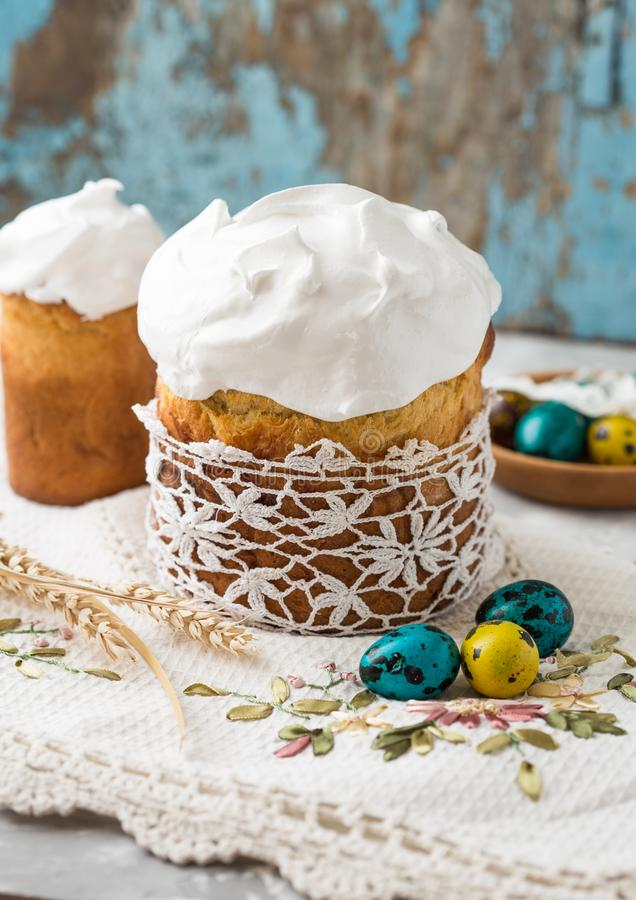Easter table setting with spring flowers, cakes and easter eggs. stock photo
