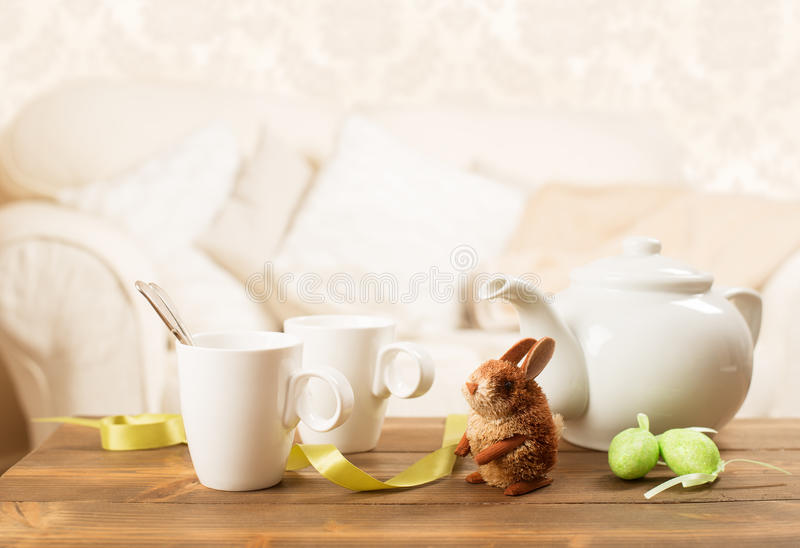 Easter Tea Break. With teapot, cups and decoration stock image