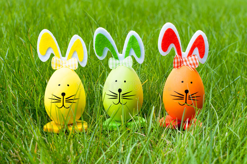 Easter bunnies on green grass royalty free stock photography