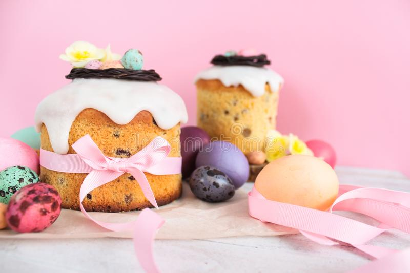 Easter traditional cake with chocolate nest, quail eggs decoration blossom flowers, colorful spring stillife in soft light and tre. Ndy pastel colors royalty free stock photography