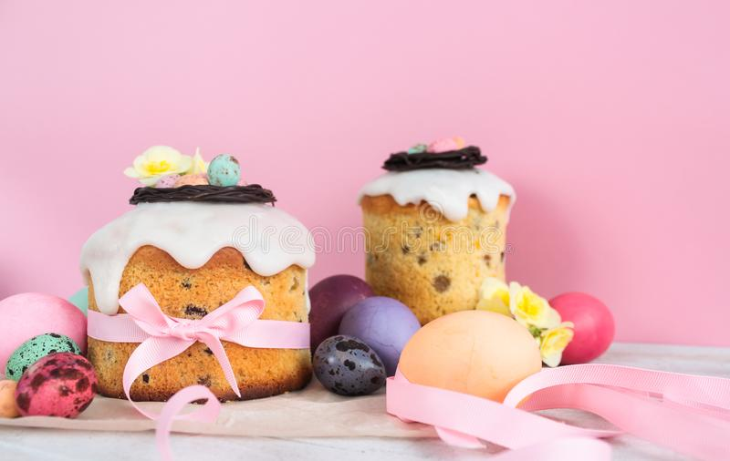 Easter traditional cake with chocolate nest, quail eggs decoration blossom flowers, colorful spring stillife in soft light and tre. Ndy pastel colors stock photography