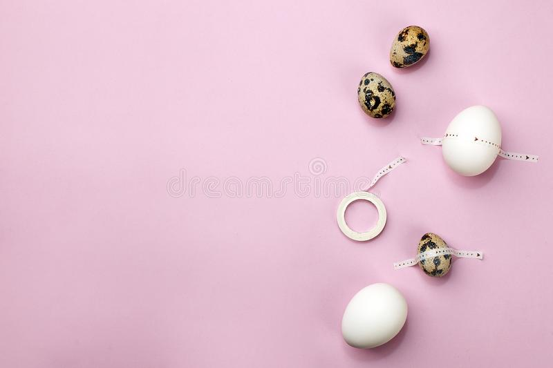 Easter vibes holiday card. Modern art. Celebrate Easter tradition. Set of eggs with scotch tape on pink purple background, minimal stock photo