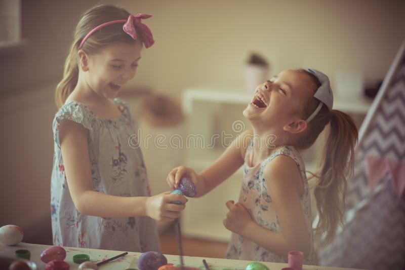 And the Easter victory is mine. Little girls having competition with Easter eggs royalty free stock photos