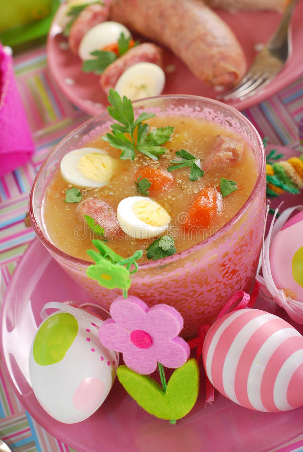 Easter White Borscht With Quail Eggs And Sausage In Pink Glass Stock Images
