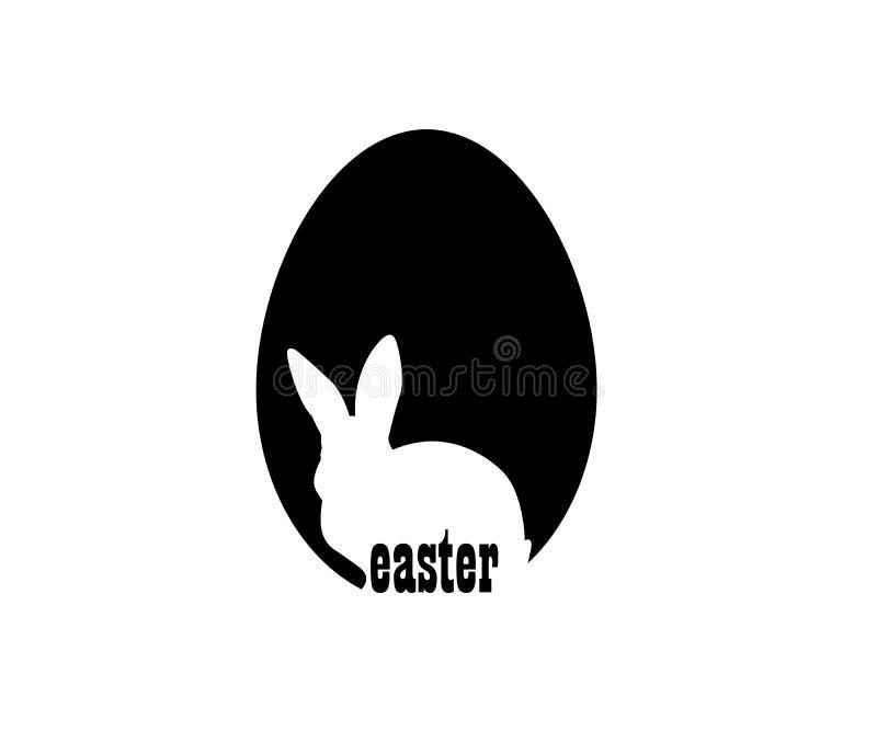 Easter The white rabbit symbol on black egg. stock photo