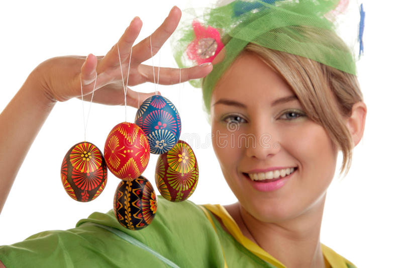 Easter woman. Spring woman with easter eggs. Focus on eggs royalty free stock photography