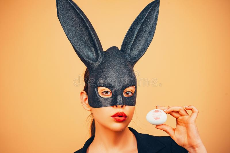 Easter woman. Happy easter. Lips and Easter, Lipstick kiss imprint on easter egg. Bunny woman. Girl with lace bunny ears stock images