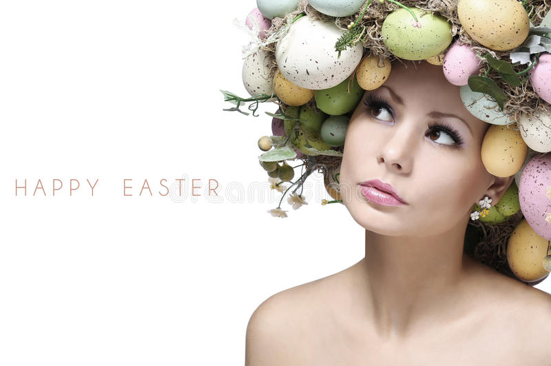 Easter Woman. Spring Girl with Fashion Hairstyle. Portrait of Beautiful Model with Colorful Eggs royalty free stock image