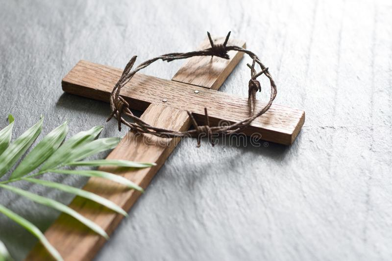 Easter wooden cross on black marble background religion abstract palm sunday concept. Closeup royalty free stock image