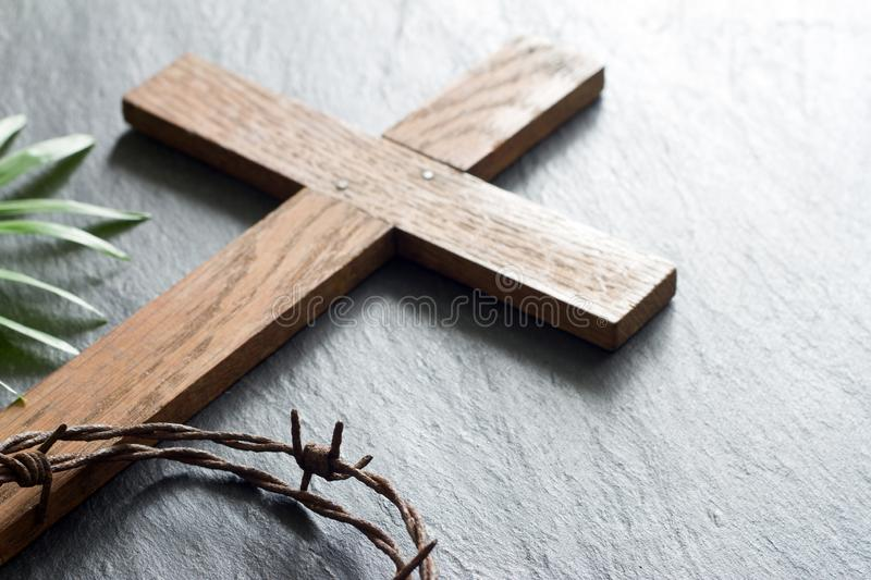 Easter wooden cross on black marble background religion abstract palm sunday concept. Closeup stock photo