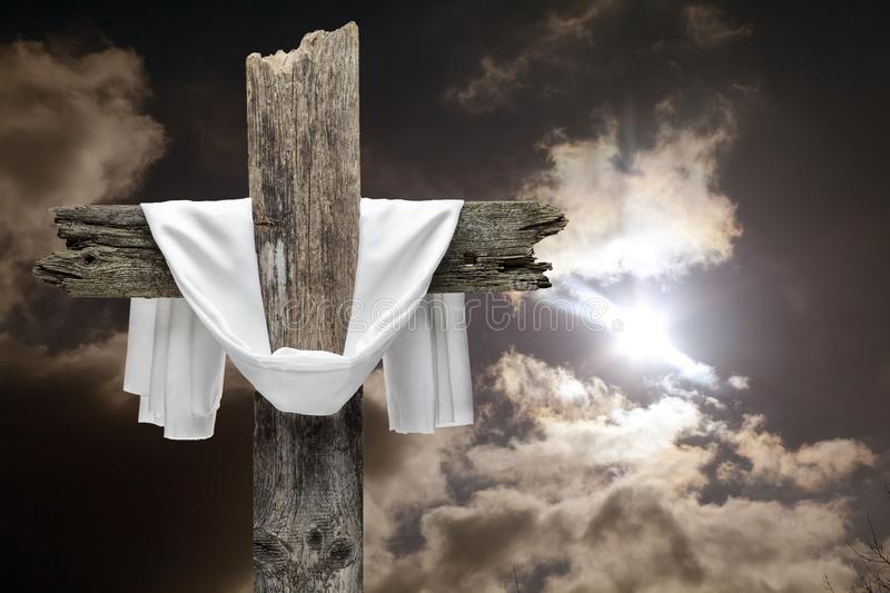Easter cross on dramatic sky. He is risen concept. royalty free stock photo