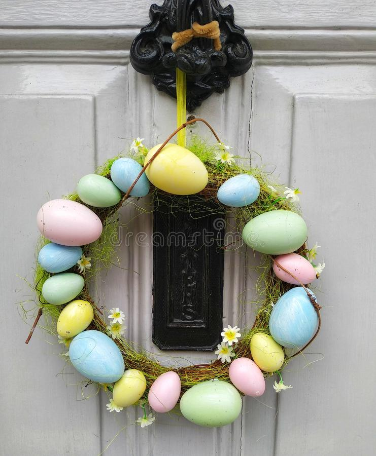 Easter wreath on front door. Eggs royalty free stock photos