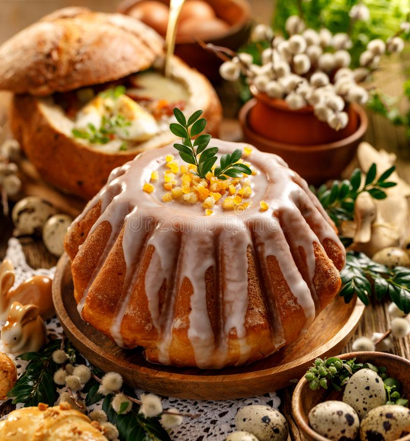 Easter yeast cake with icing and candied orange peel, delicious Easter dessert royalty free stock images