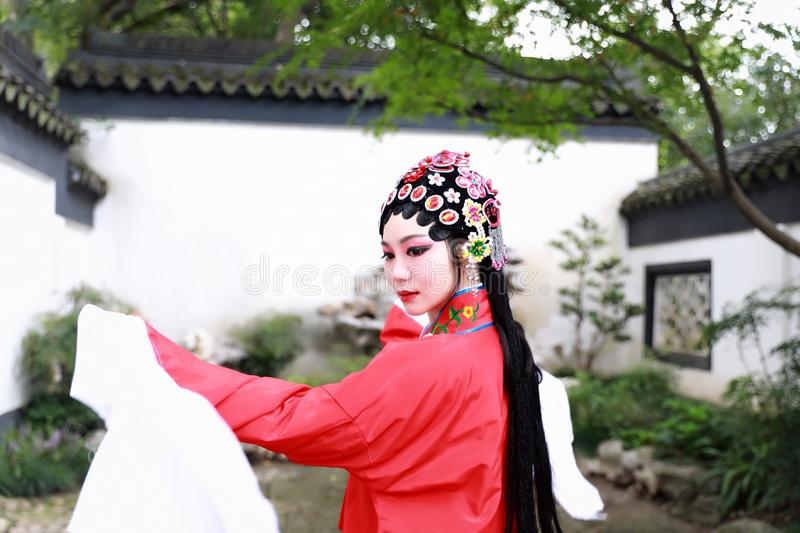 Aisa Chinese woman Peking Beijing Opera Costumes Pavilion garden China traditional role drama play bride dance perform royalty free stock photo
