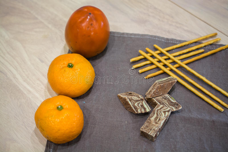 Eastern Dessert On A Napkin. Few Salty Bread Sticks And Fruits On a Table stock photography