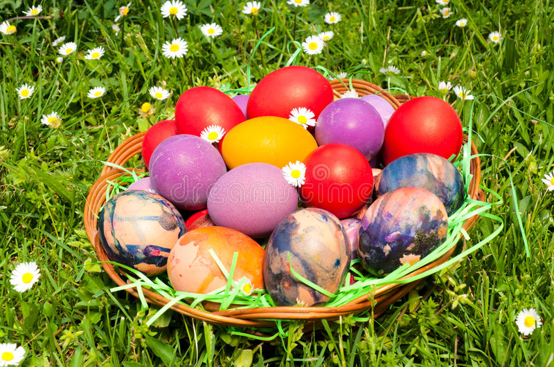 Eastern eggs. In the wooden basket royalty free stock images