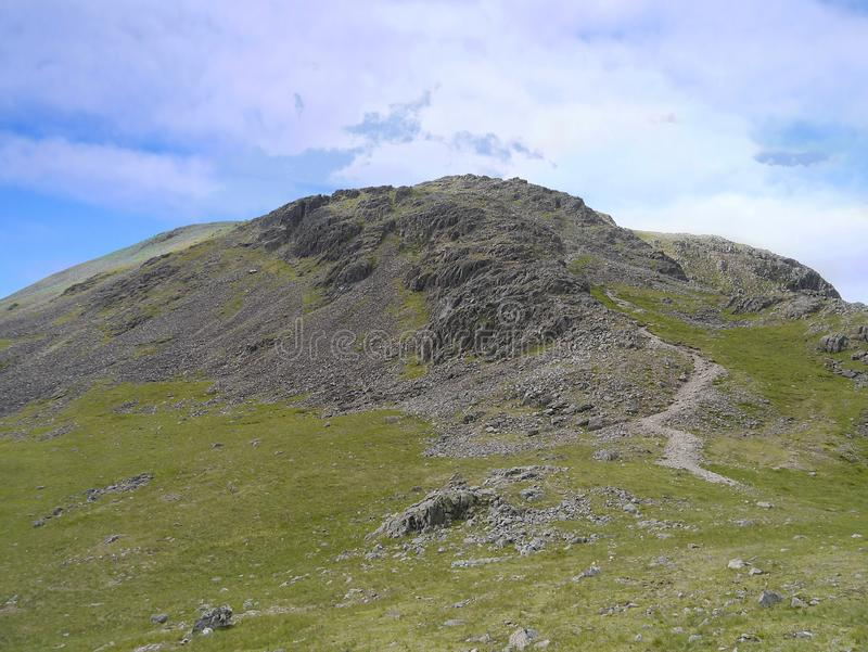 Rib End, eastern end of Kirk Fell. The eastern end of Kirk Fell is normally access this way up Rib End, a path of boulders, don`t say you`re not tempted stock photography