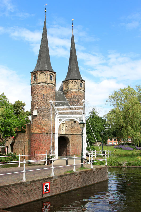 Eastern Gate in Delft, Netherlands. The Eastern Gate (Oostpoort) in the historical town of Delft is an example of Brick Gothic northern European architecture and royalty free stock photos