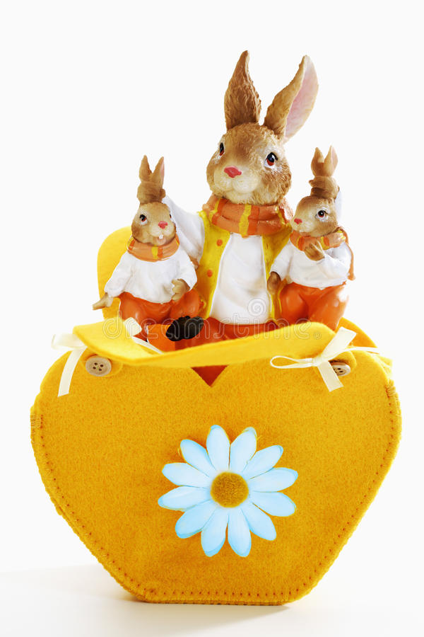 Eastern, heart-shaped bag with easter bunny figurines stock image