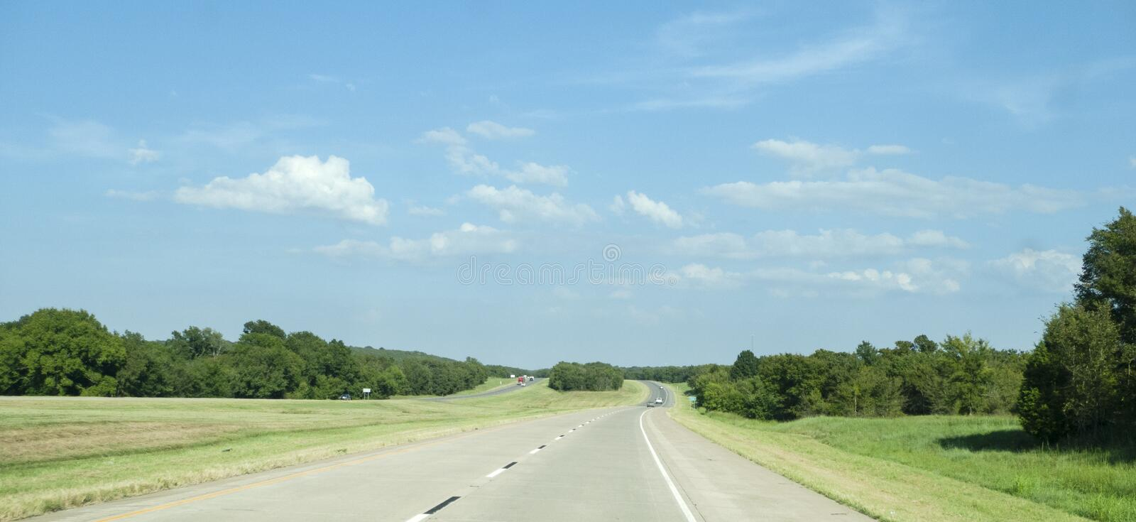 Eastern Oklahoma summer landscape with four lane highway stock images