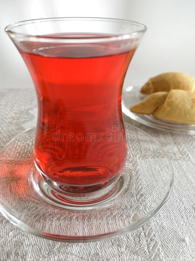 Eastern red tea karkade in a traditional Turkish glass. stock photos