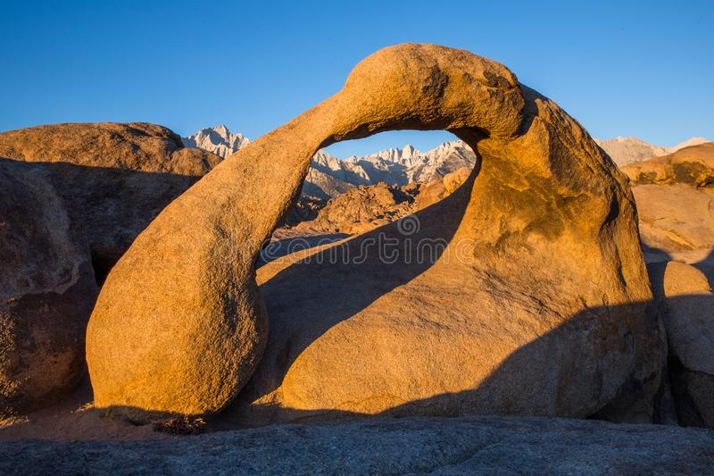 Eastern Sierra Mountain Range in early morning light sunrise on Mobius Arch in Alabama Hills. Sunrise over the Eastern Sierra Mountains and Mobius Arch in the royalty free stock photography