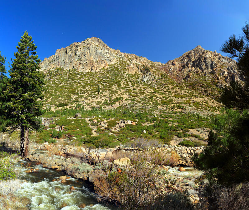 Rugged Landscape of the Eastern Sierra Nevada near Carson Pass, California, United States. The West Fork of the Carson River tumbles over rapids at the foot of a royalty free stock images