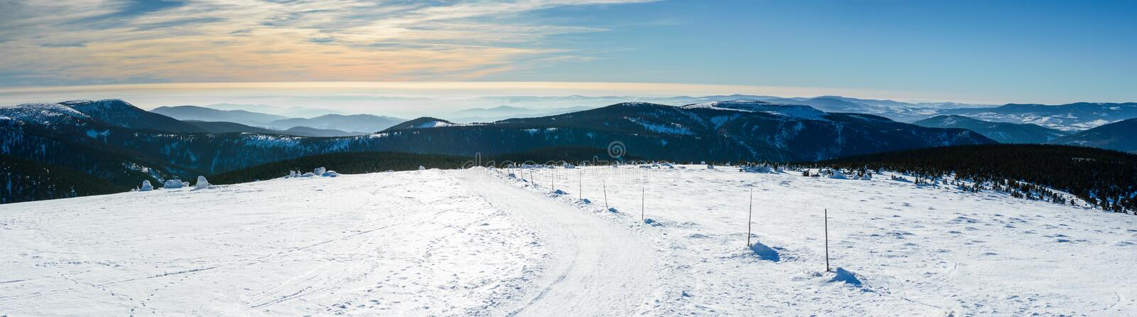 Eastern Sudetes, winter landscape with a panorama of the mountain peaks royalty free stock images
