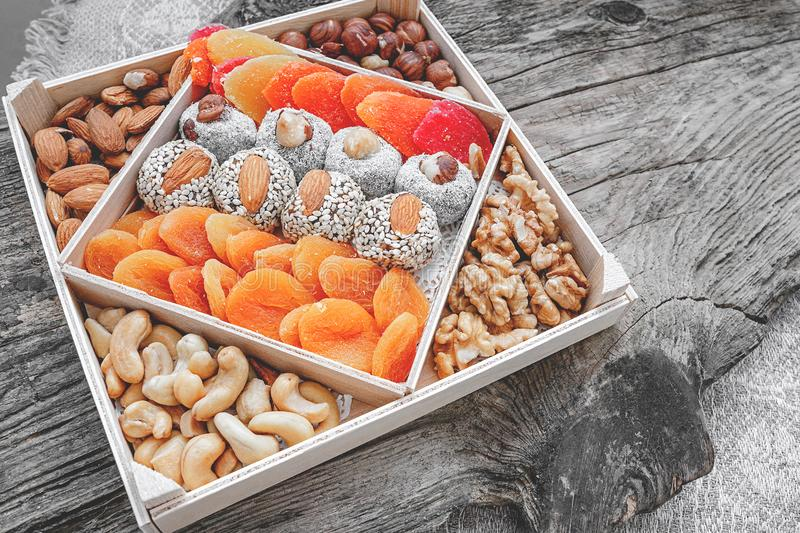 Eastern sweets dried fruits and nuts in a wooden box. Background. Healthy vegan food. Natural food stock photography