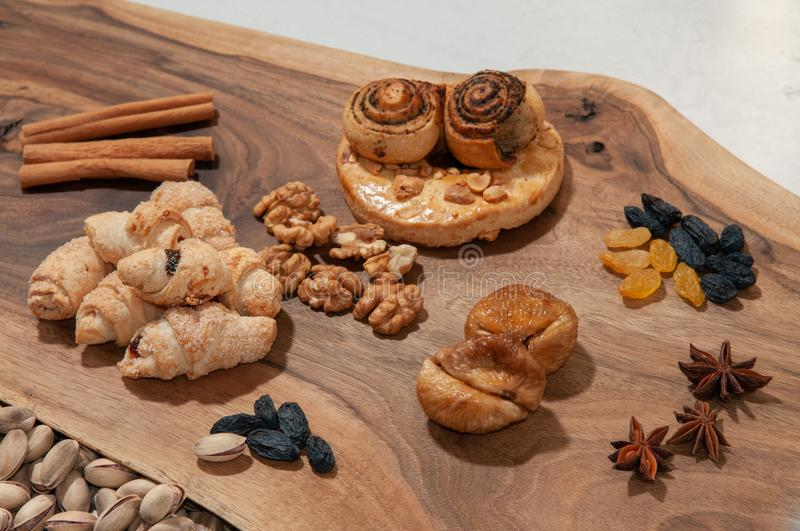 Eastern sweets and pastries lie on a coaxial cut of a wooden board stock image