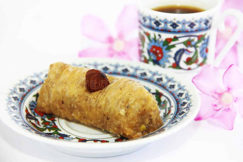 Eastern Turkish traditional sweet baklava on colorful plate and a cup of coffee royalty free stock images