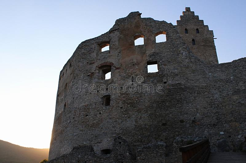 Eastern wall of early medieval inner courtyard of Topolcany castle during sunset. royalty free stock images