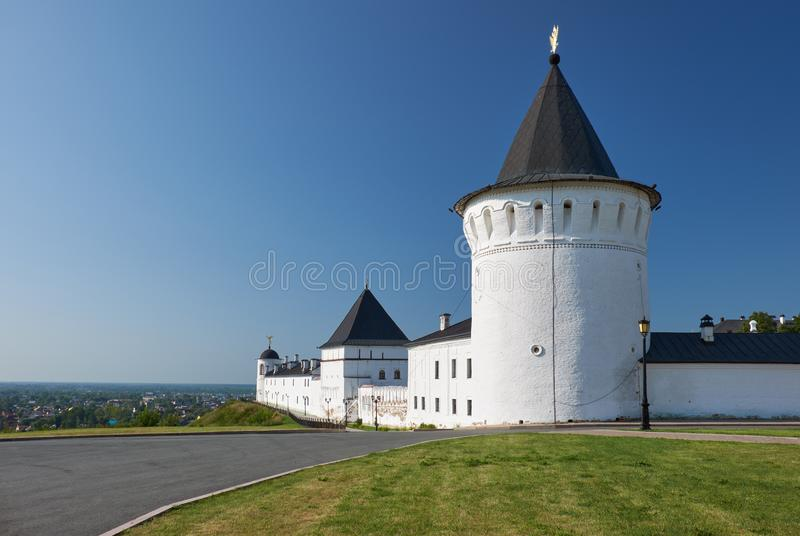 The eastern wall of Tobolsk Kremlin. Tobolsk. Siberia. Russia. The view of the eastern wall of Tobolsk Kremlin with the Brotherly housing and three towers stock images