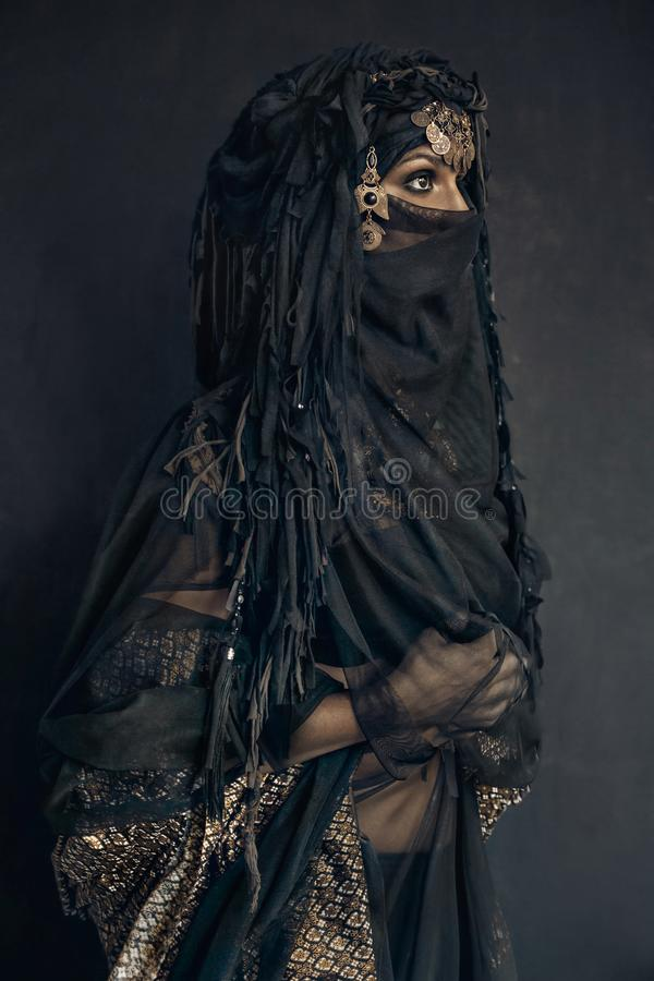 Eastern woman princess costume conceptual portrait. Eastern woman princess costume concept royalty free stock photos