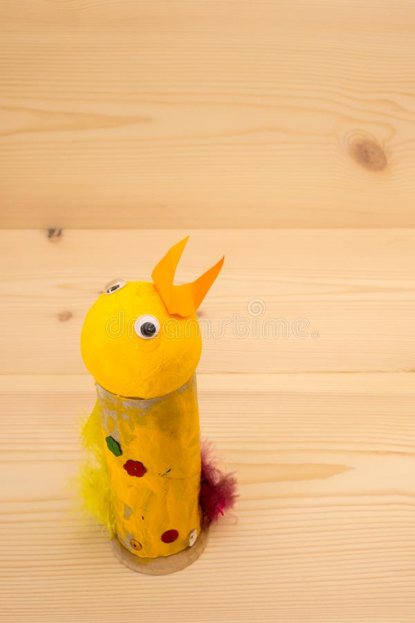 Easy easter craft, homemade chicken. Easy easter craft. Homemade chicken made of a paper roll, feathers and paint. Fun with kids stock photos