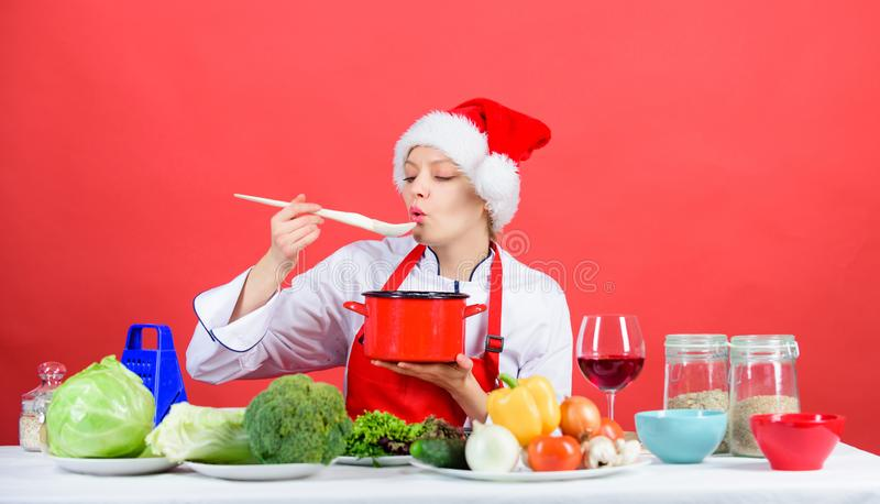 Easy ideas for christmas party. Healthy christmas holiday recipes. Woman chef santa hat cooking hold wooden spoons. Best stock images