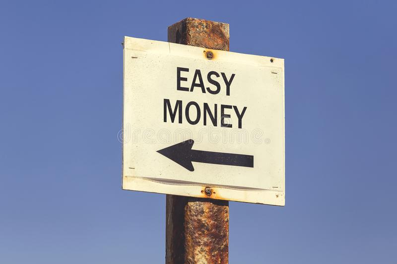 Easy money and arrow signpost 2 stock images