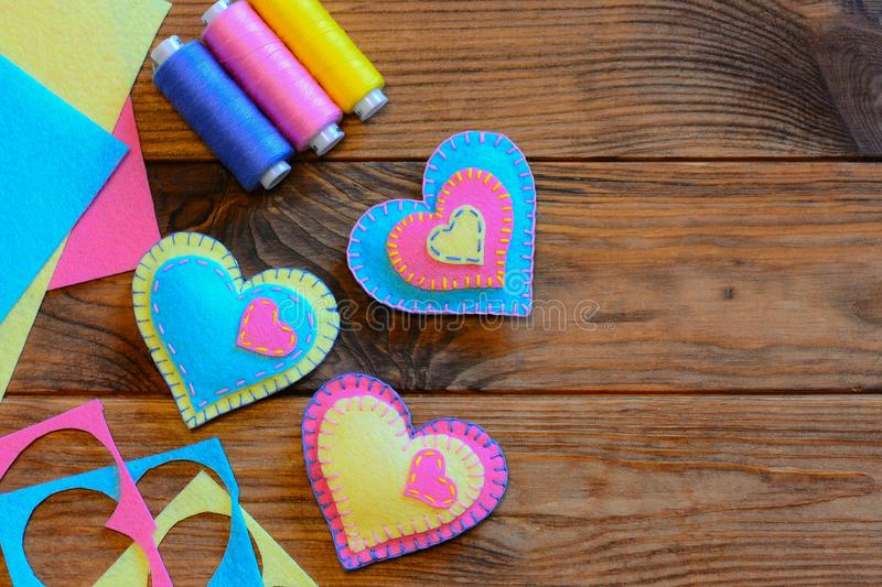 Valentines day heart ornaments. Creative heart ornaments, thread set, felt sheets on a wooden table. Quick and easy sewing project. Easy sewing hobby. Sewing royalty free stock image