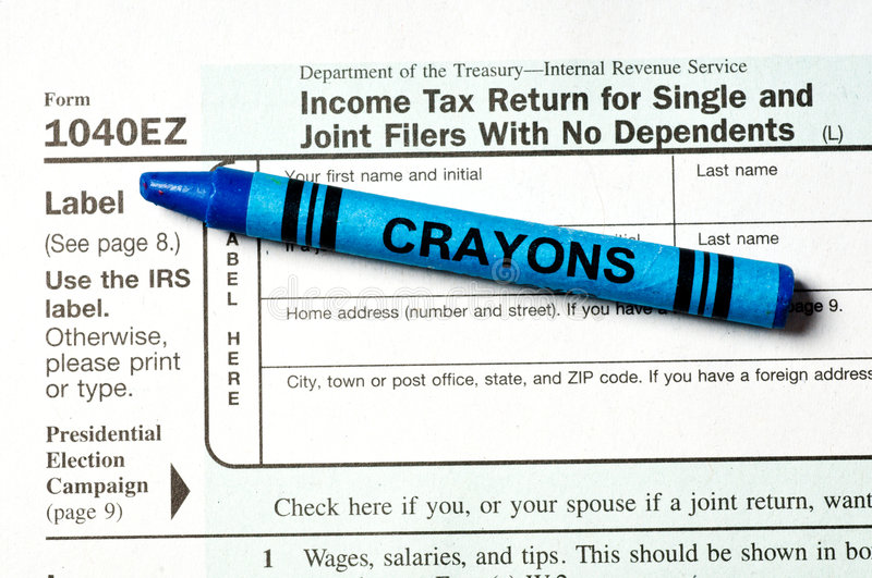 Easy Tax Form. The 1040EZ tax form with blue crayon depicting ease of use - a child could do it royalty free stock photography