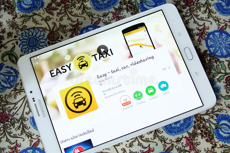 Easy Taxi , Taxi Cab App. Downloading Easy Taxi , Taxi Cab App from google play store on samsung tablet. Easy Taxi is the world's fastest free taxi app stock image