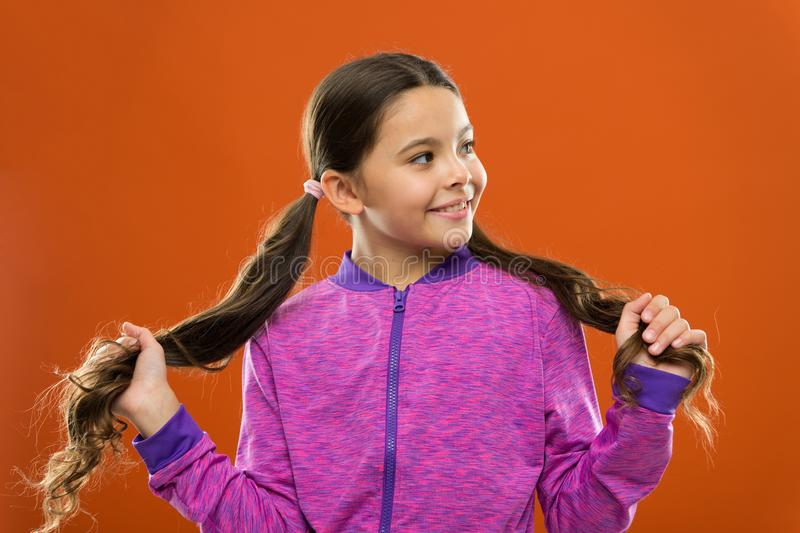 Easy tips making hairstyle for kids. Comfortable hairstyle for active lifestyle. Charming beauty. Girl active kid with royalty free stock photo