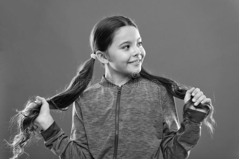 Easy tips making hairstyle for kids. Comfortable hairstyle for active lifestyle. Charming beauty. Girl active kid with stock image