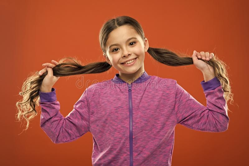 Easy tips making hairstyle for kids. Small child long hair. Charming beauty. Girl active kid with long gorgeous hair royalty free stock photos