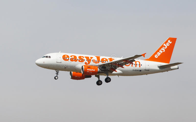 Easyjet Airbus A319. An Easyjet Airbus A319 approaching to the El Prat Airport in Barcelona, Spain royalty free stock image